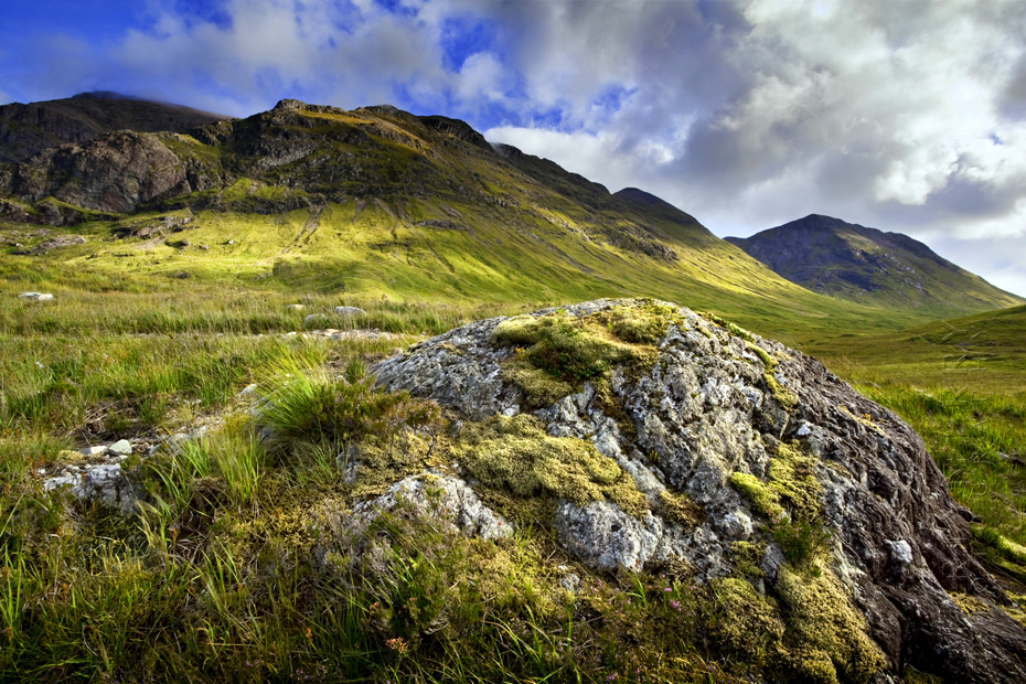 Photograph of a verdant Etive Mor on a sunny afternoon under blue sky