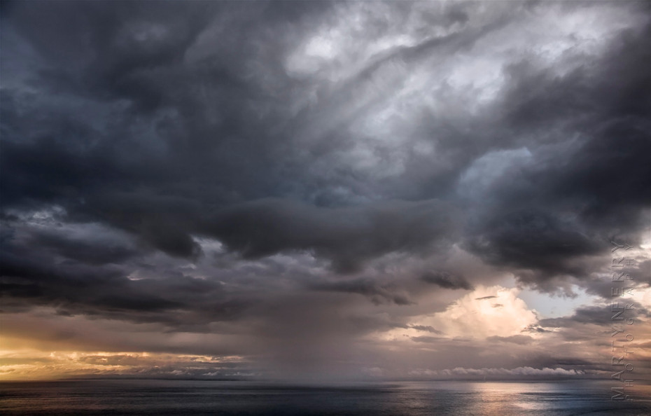 Dramatic storm over the ocean at sunset