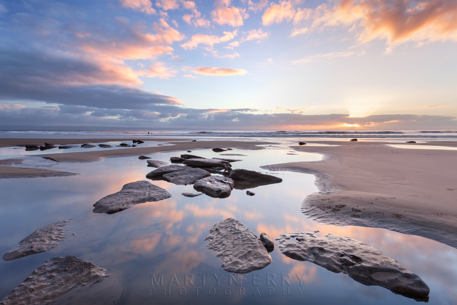 Beach landscape at sunset on Dunraven Bay in Wales