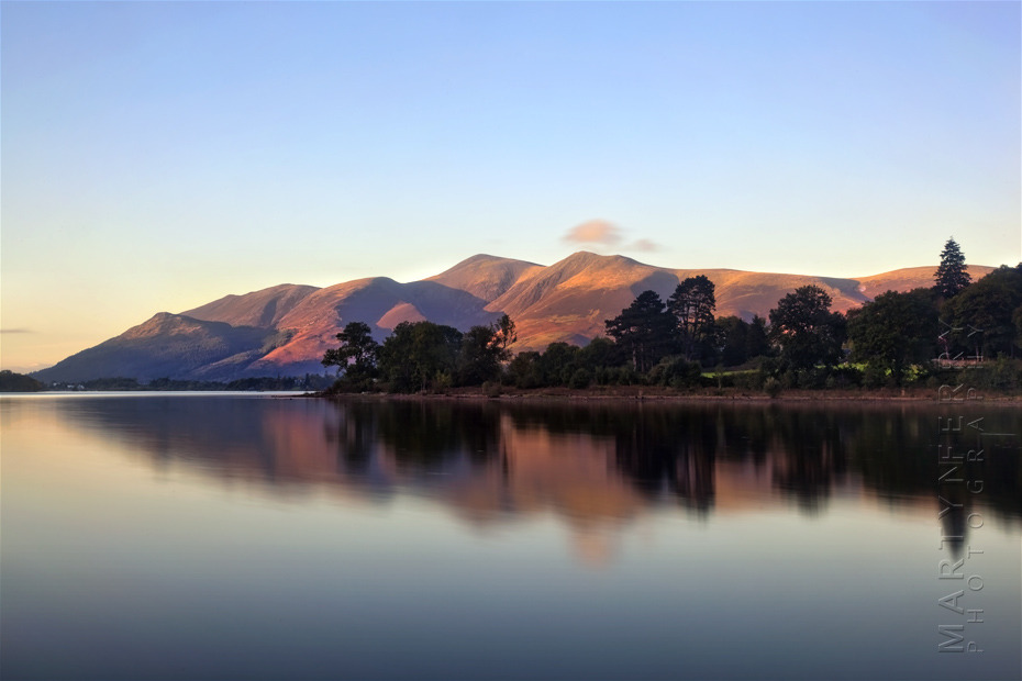 Derwentwater at sunset with calm reflection