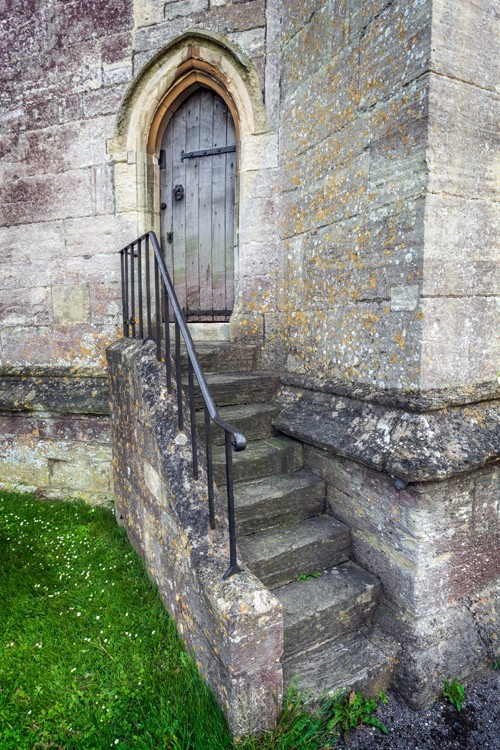 Ancient door at St. Mary's Church in the Cotswold town of Painswick