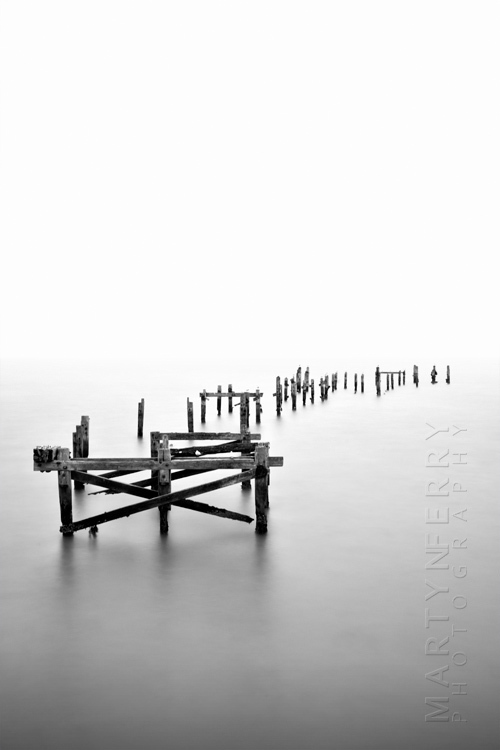 Swanage old wooden pier in black and white