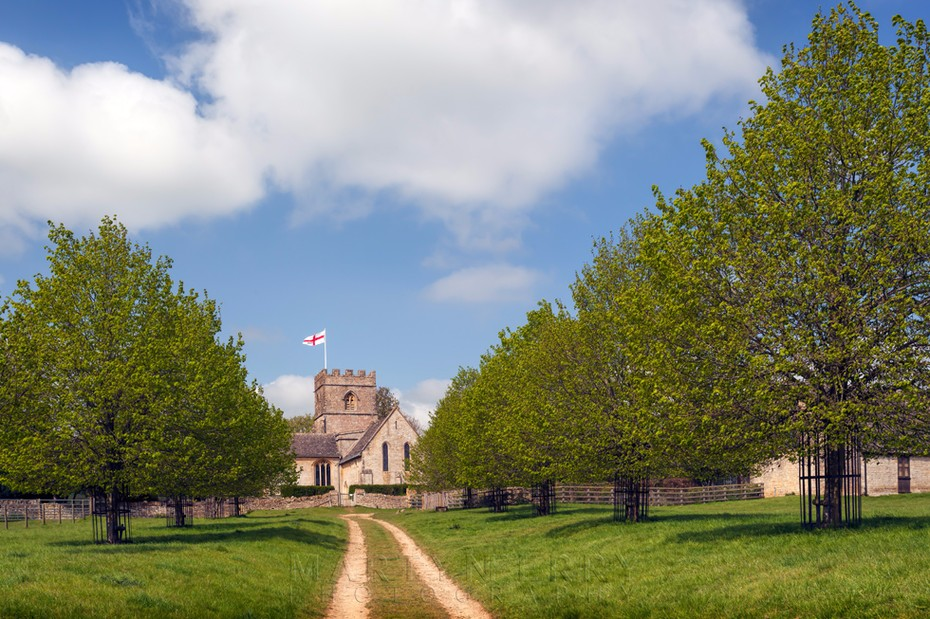 Guiting Power church with tree lined path