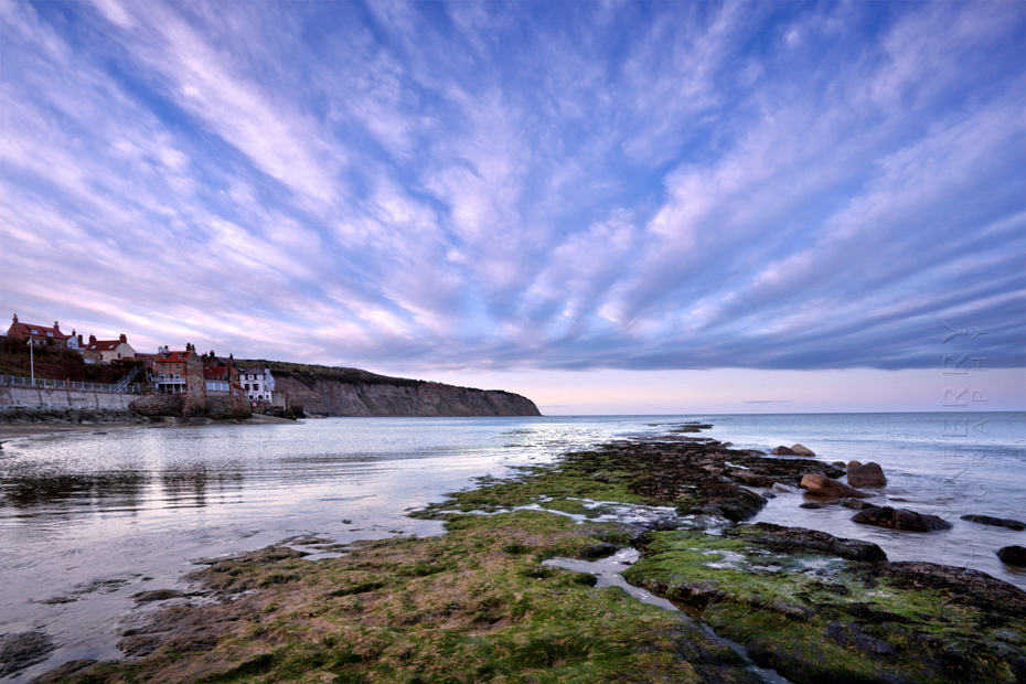Striking image of clouds above Robin Hoods Bay in North Yorkshire at sunset