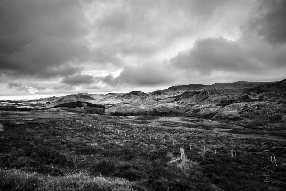 Dramatic black and white photo of the Caringorms under stormy clouds