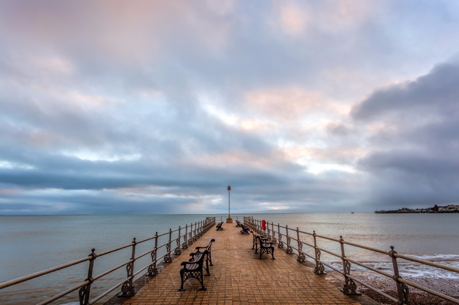 Sunrise over Banjo Pier in Swanage on the Dorset coast