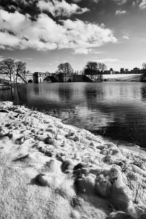 Black and white image of Blenheim Palace park under a covering of snow