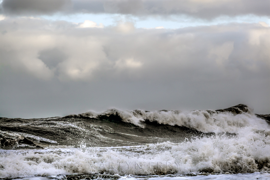 Stormy waves under clouds at Whitley Bay