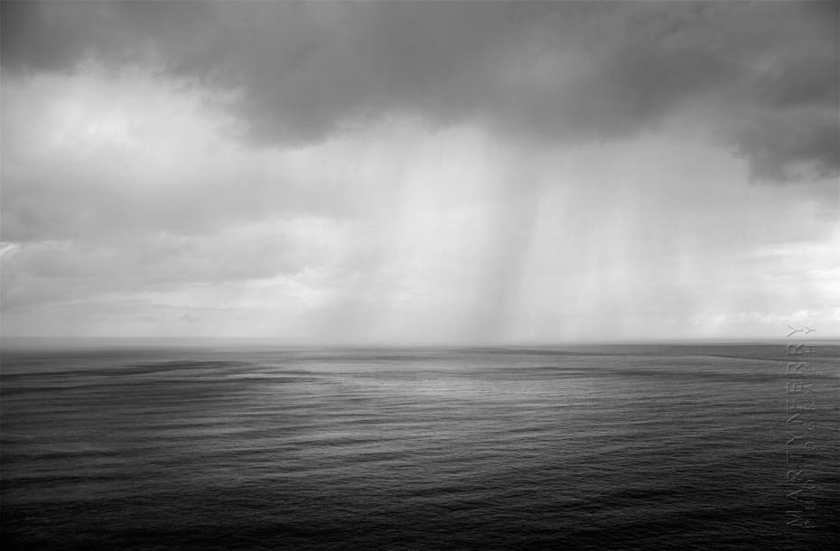 Dramatic image of rain falling onto the ocean