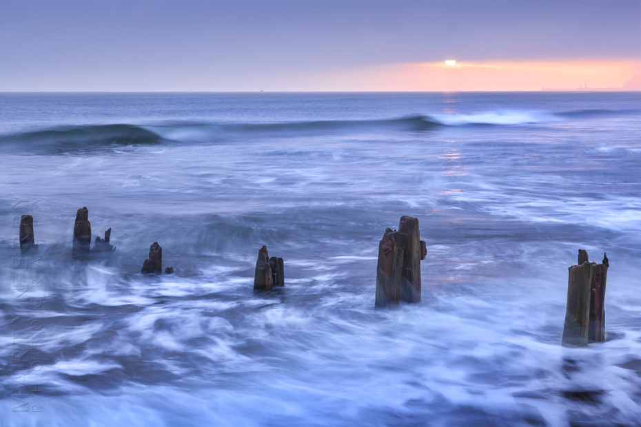 Beautiful sunrise photograph of Sandsend beach in North Yorkshire
