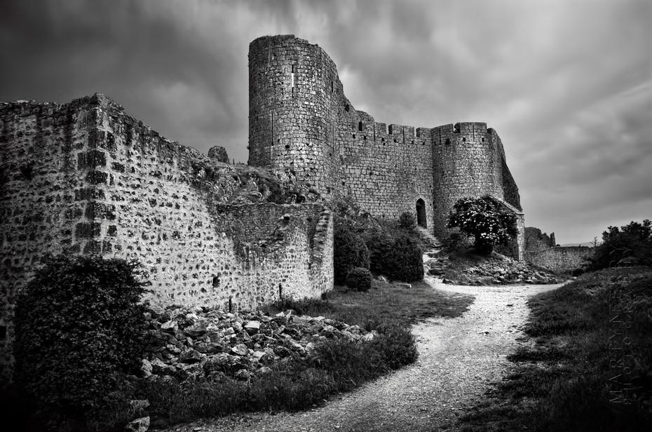 Striking black and white image of Chateau de Peyrepertuse