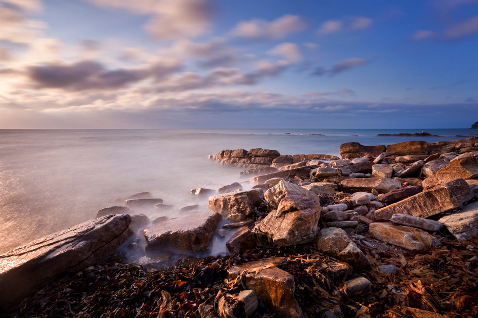 Beautiful warm sunlight on coastal rocks in Dorset