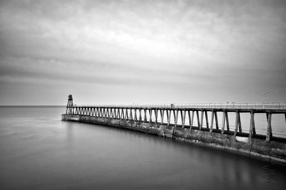 Dramatic photograph of Whitby pier in black and white