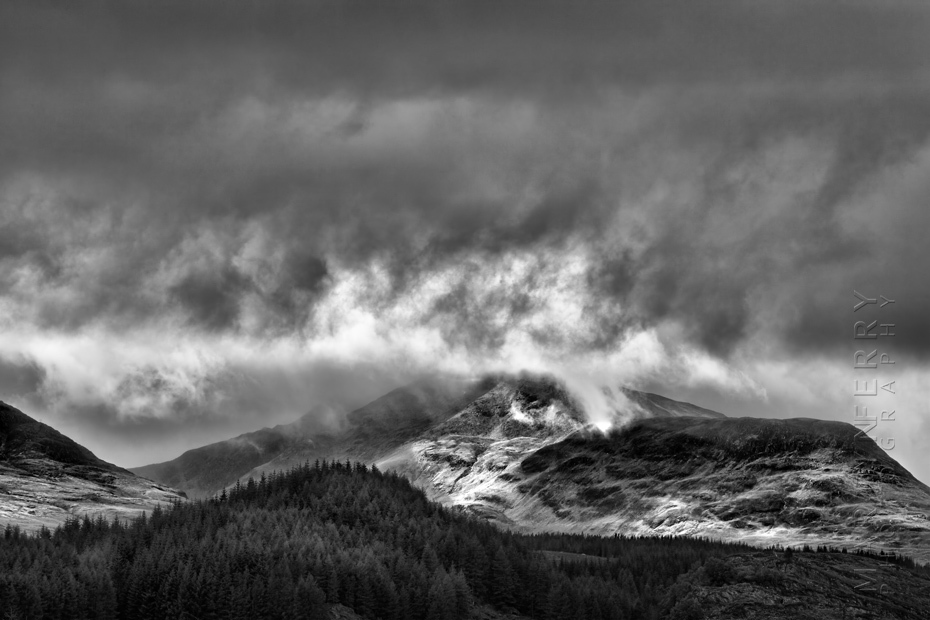 Black and white landscape photo of the Cairngorms under stormy skies