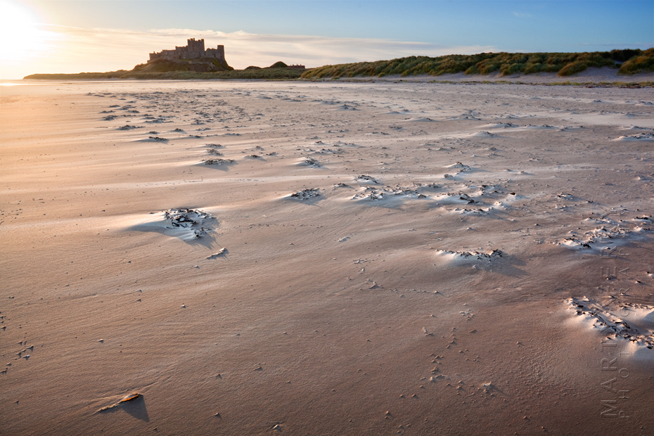 Sunrise over the windswept beach at Bamburgh