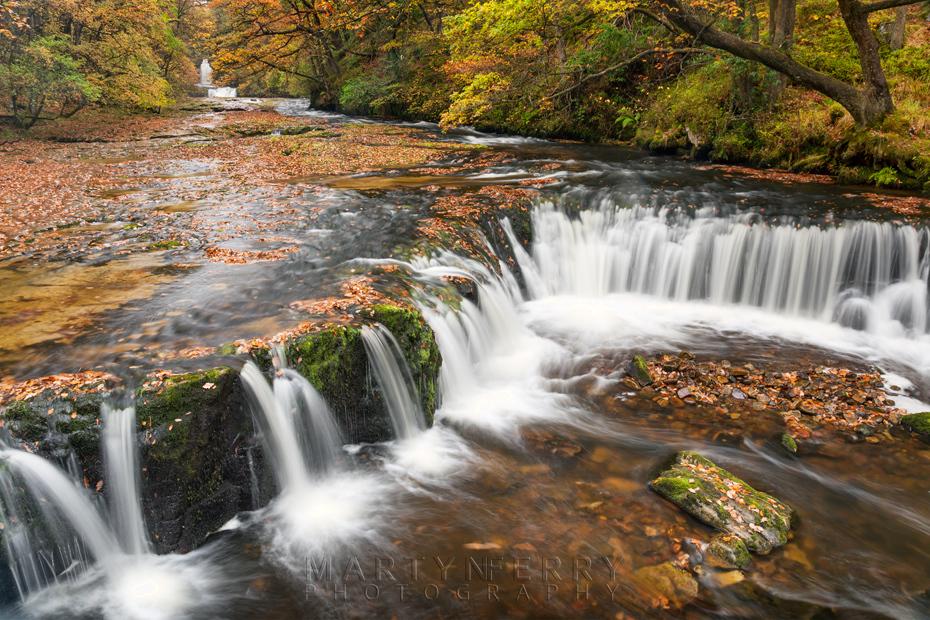 Horseshoe Falls beneath the colours of autumn in Wales