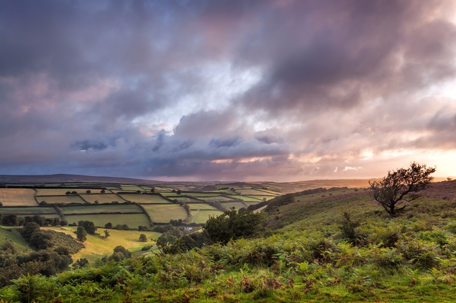 Sunrise clouds over the Punchbowl in Exmoor National Park