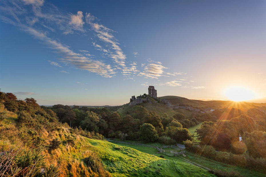 Sunrise behind the iconic ruins of Corfe Castle in Dorset