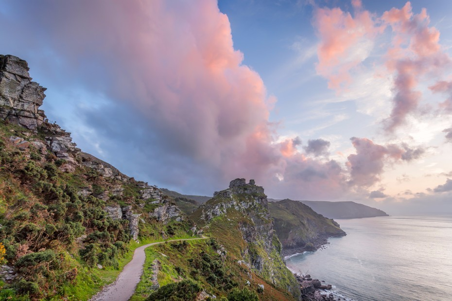 Beautiful pink clouds over Castle Rock at Valley of Rocks in Exmoor