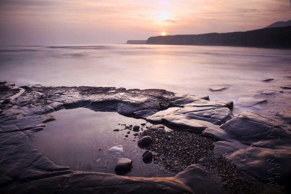 Warm sunset photo of rocks at Kimmeridge Bay