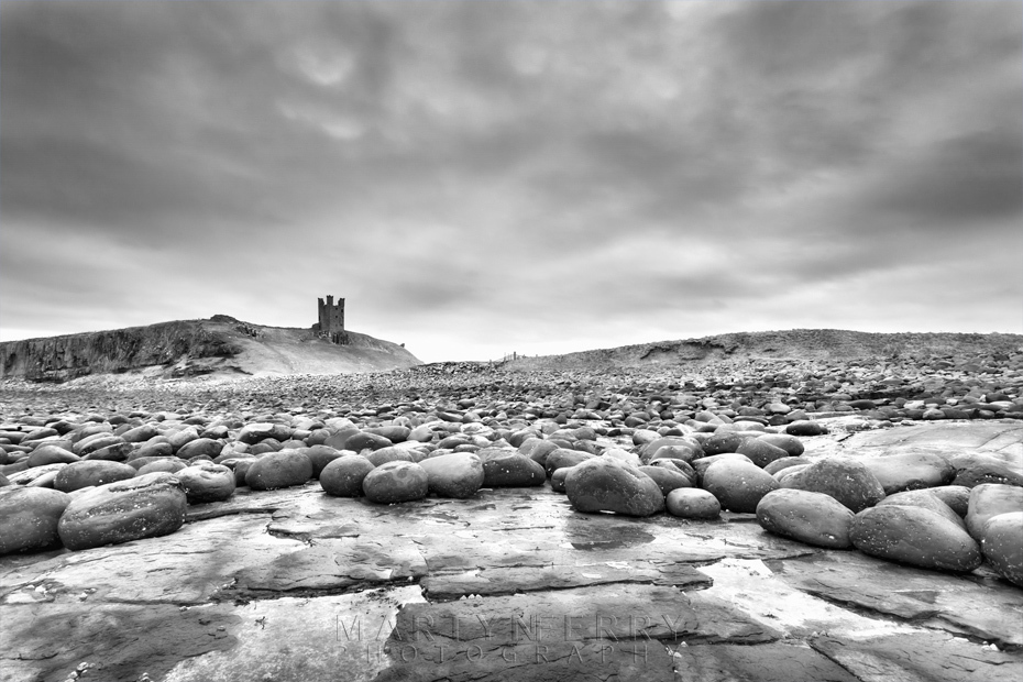 Dunstanburgh Castle in black and white