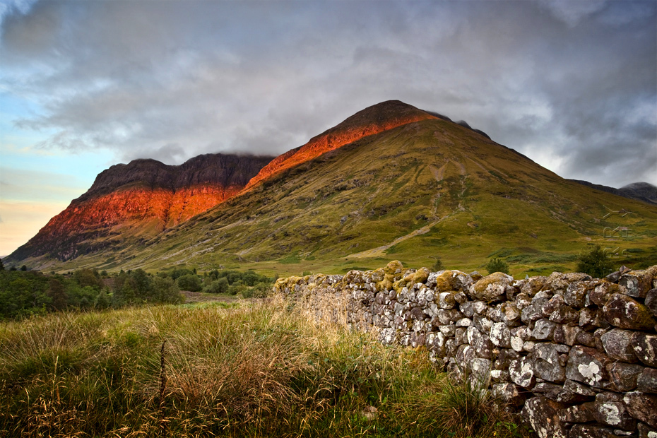 Beautiful image of sunset light on the flanks of the Three Sisters in Glen Coe