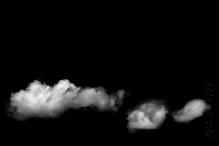 Fine art photography of clouds floating in black nothingness