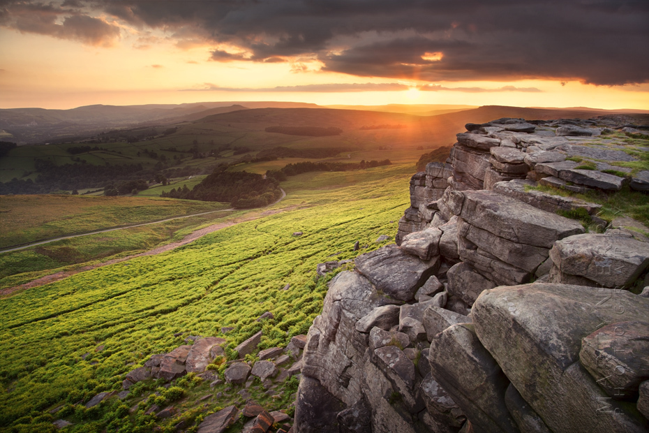 Evening photography at Stanage edge with sunset and clouds