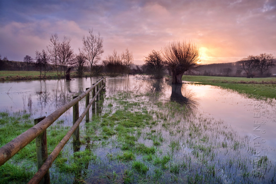 Beautiful photograph of a Cotswold sunrise over the River Windrush
