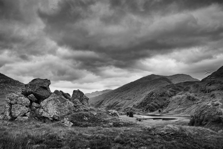 Landscape image of Loch Coire Shubh and foreground rocks