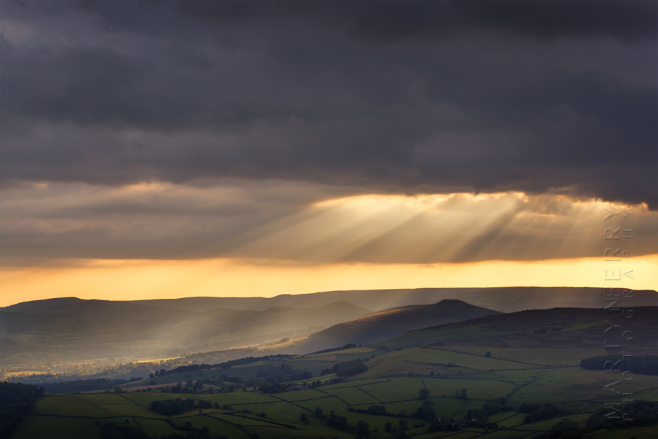 Sunbeams break through the clouds at Stanage Edge