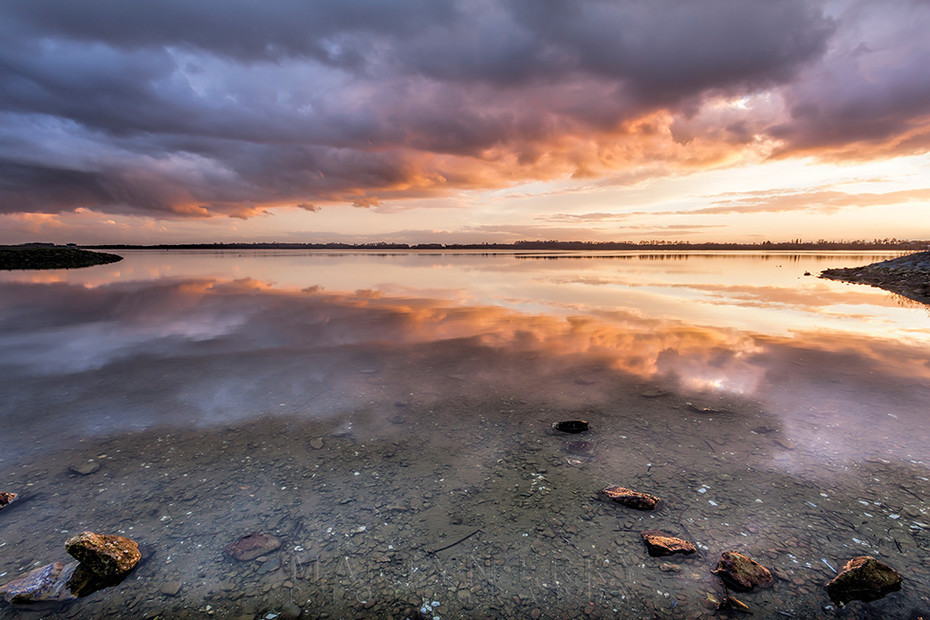 Storm clouds reflect in the lake at Grafham Water