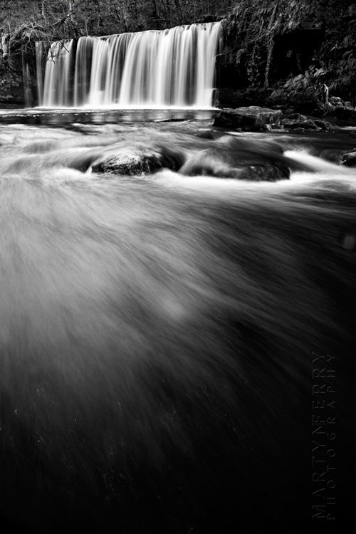 Striking black and white photograph of Upper Gushing Falls