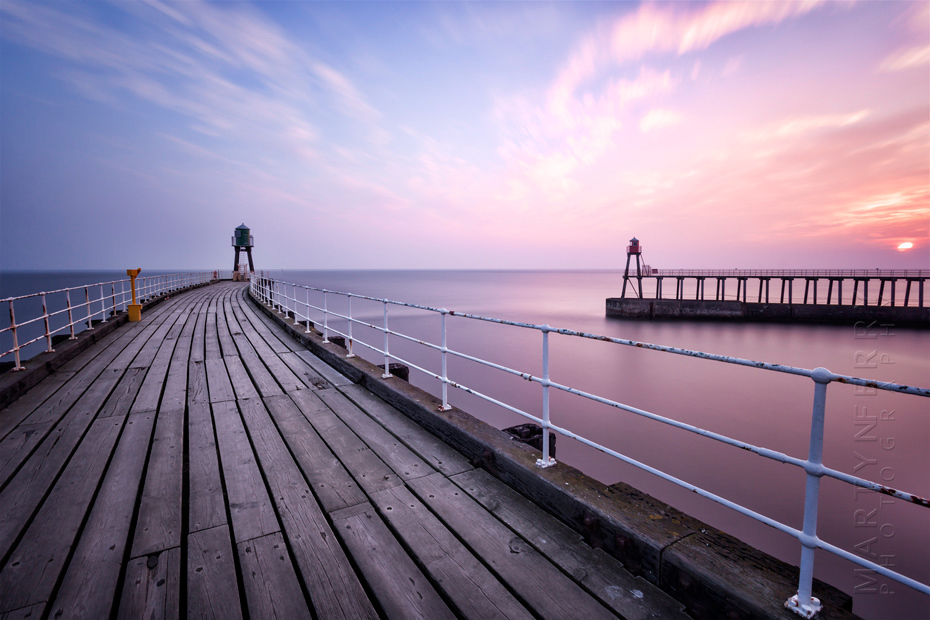 Beautiful photograph of Whitby piers at sunrise
