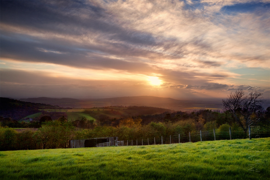 Beautiful landscape photograph of sunset over the Cotswolds