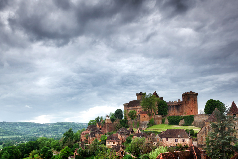 Stormy image of the medieval village of Bretenoux in the Dordogne