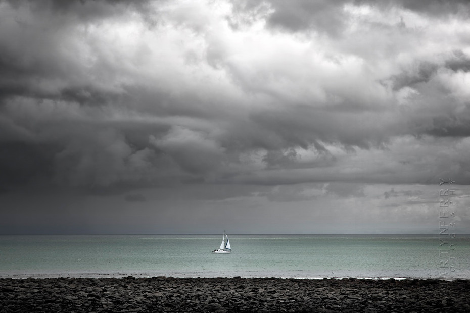 Incredible storm clouds over lone boat at Lynton