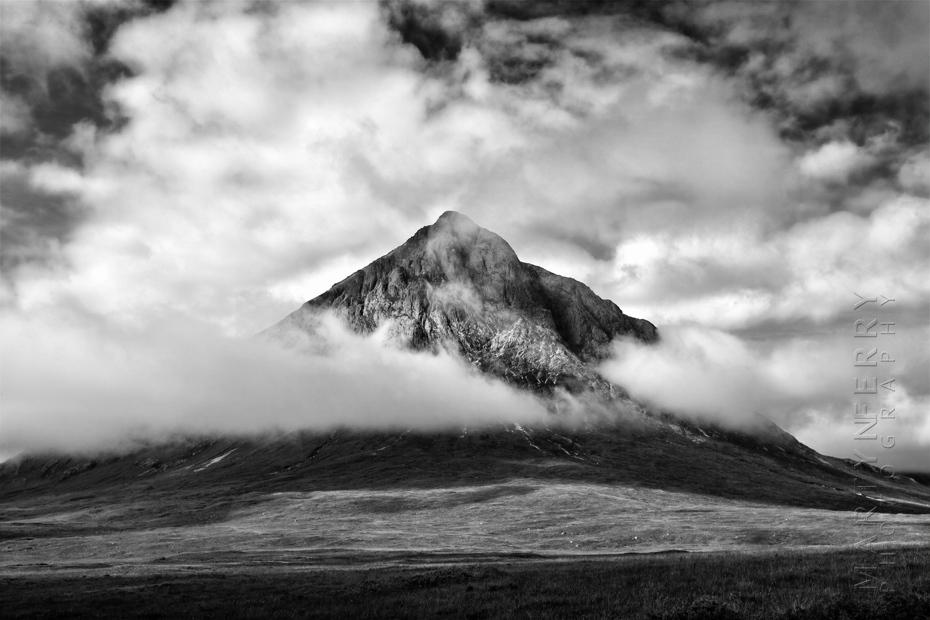 Impressive photograph of Buachaille Etive Mor surrounded by clouds