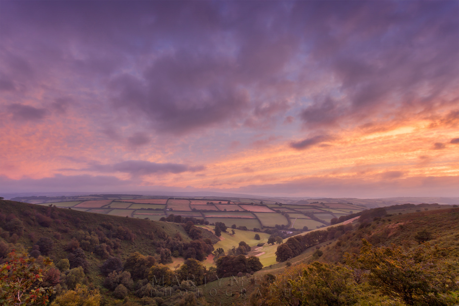 Colourful sunrise image of The Punchbowl from Winsford Hill