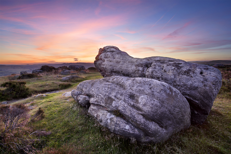 Beautiful sunset photo of rock at Baslow Edge