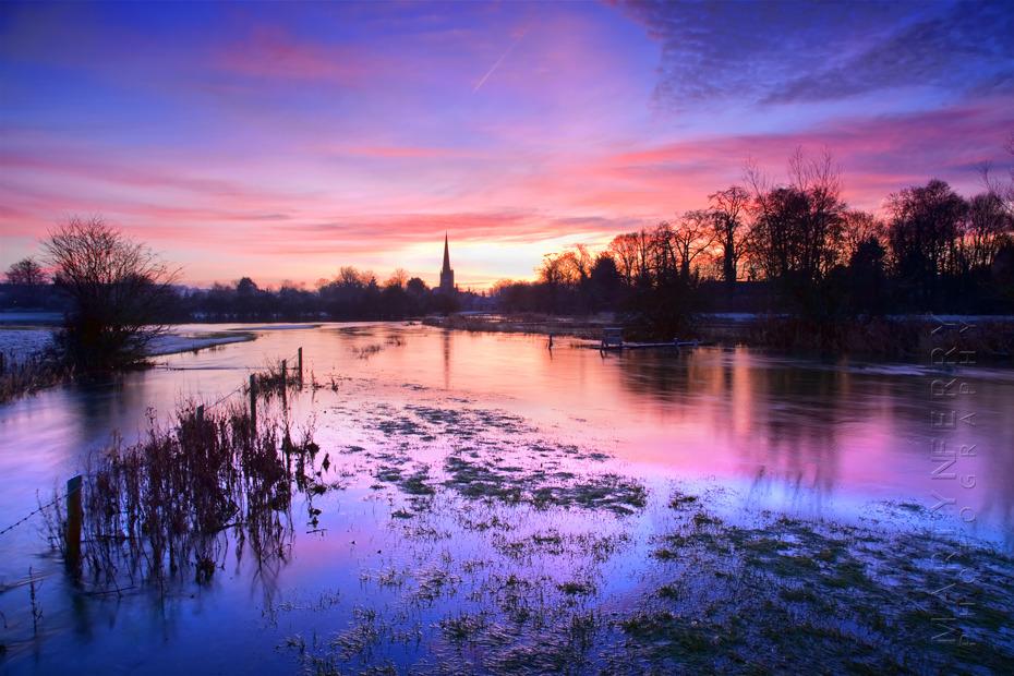 Stunning landscape photograph of Burford at sunrise