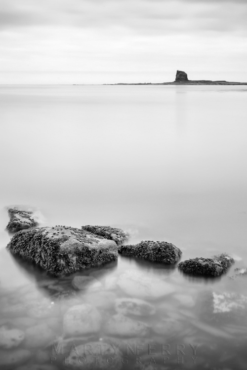 Saltwick Bay image in black and white of Black Nab and rocks