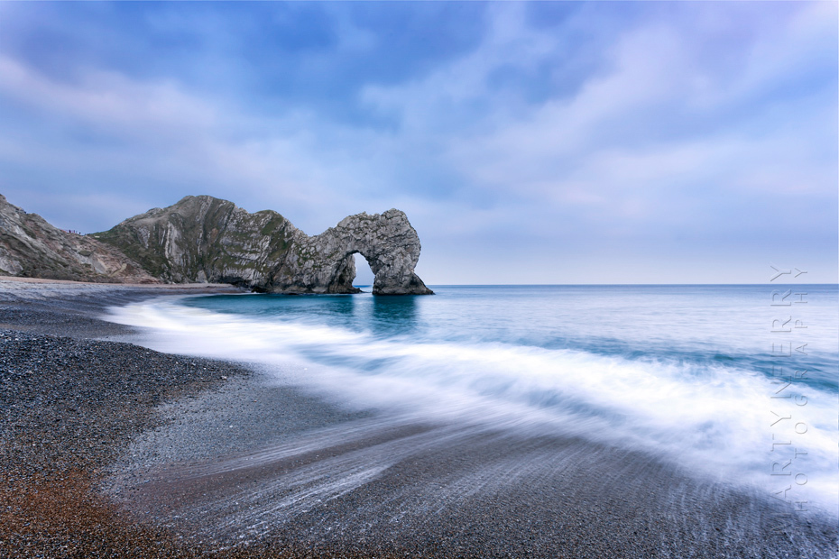 Waves on the beach at Durdle Door on the Dorset coast