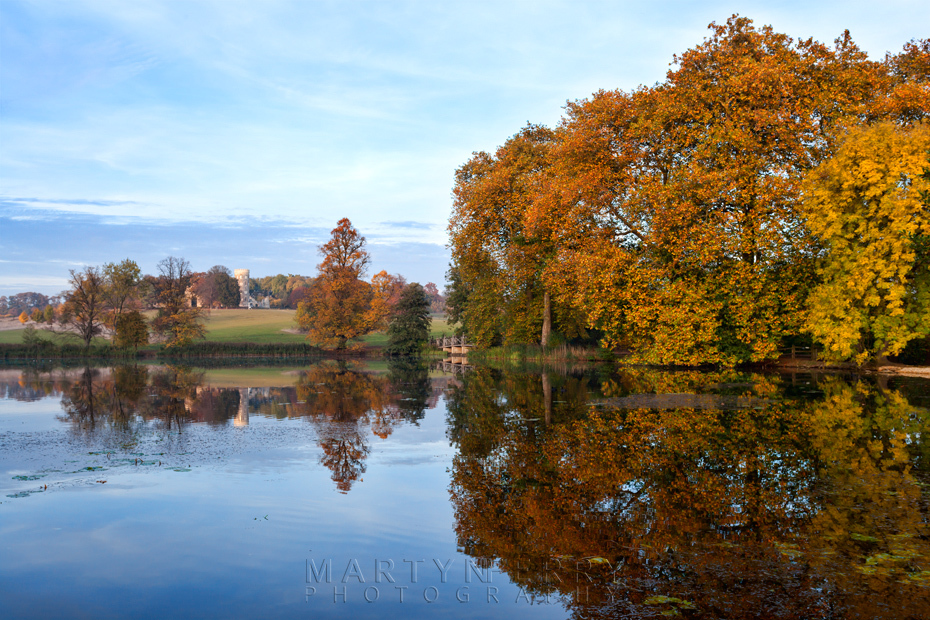 Autumn trees reflection at Wimpole Estate