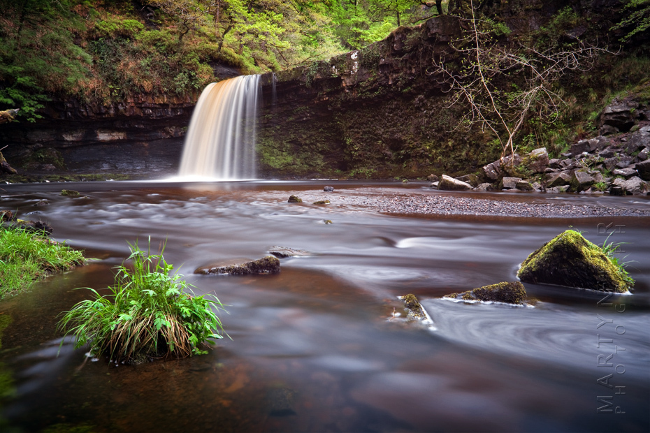Landscape image of Welsh waterfall in Spring