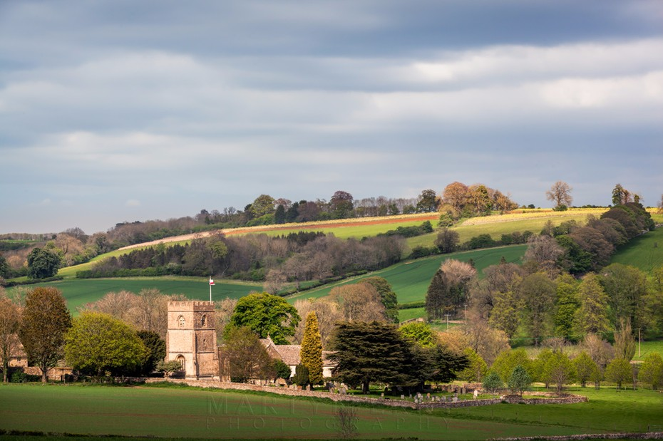 Guiting Power church and surrounding landscape in the Cotswolds