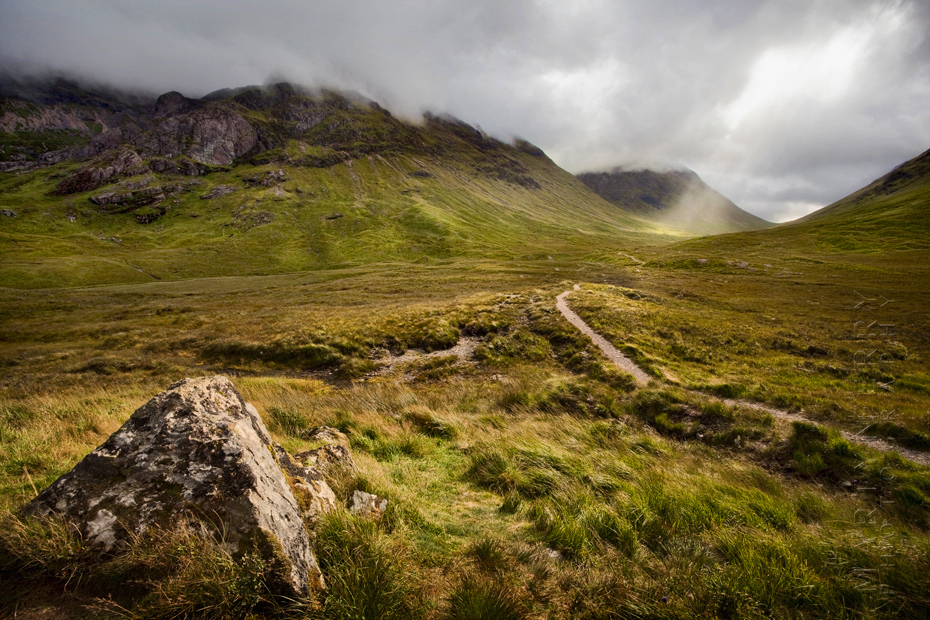 Image of sunlight breaking through clouds in the distance at Etive Mor