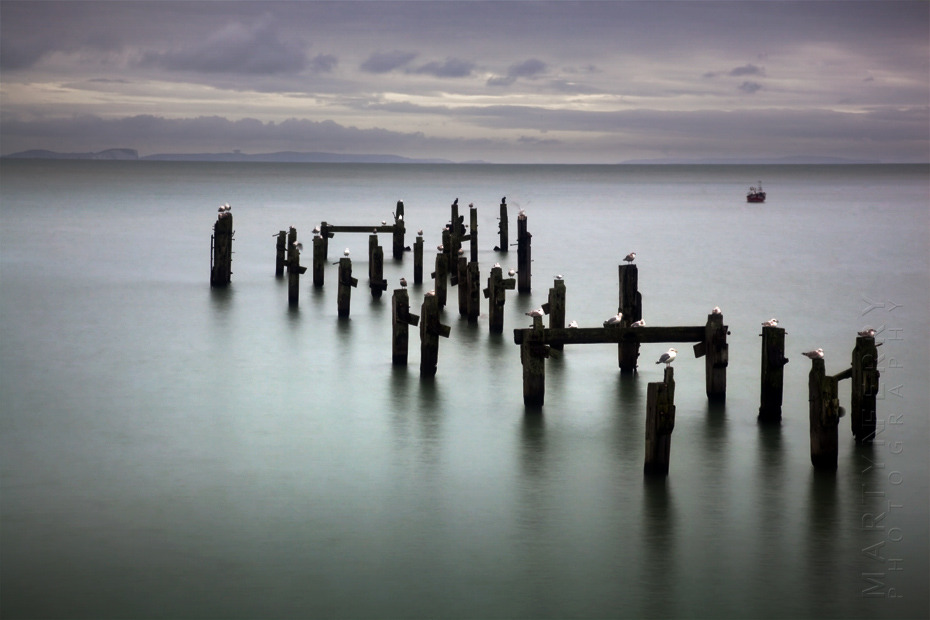 Seascape image of pier ruins at Swanage
