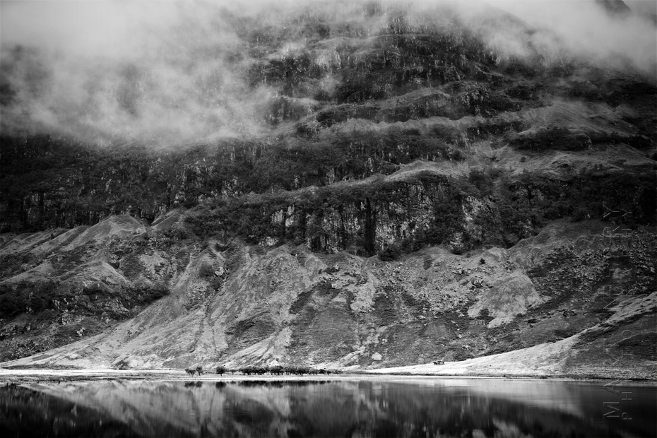 Dramatic photograph of Loch Achtriochtan with low cloud