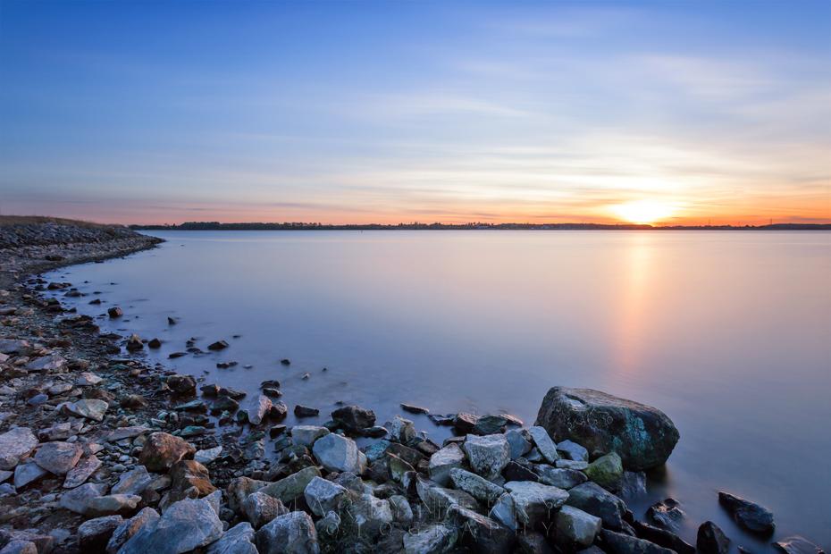 Sunbeam reflects over Grafham Water reservoir